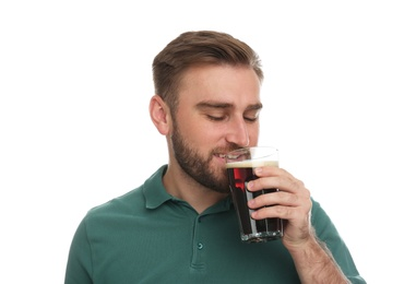 Handsome man with cold kvass on white background. Traditional Russian summer drink