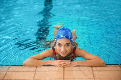 Young athletic woman in swimming pool