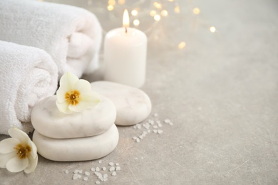 Spa composition with towels on light background, space for text