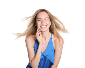 Portrait of beautiful young woman with blonde hair on white background