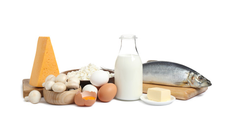 Fresh products rich in vitamin D on white background