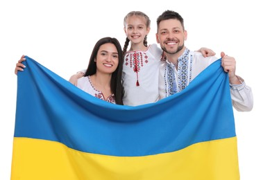 Happy family in national clothes with flag of Ukraine on white background