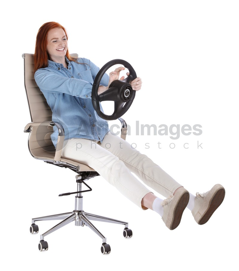 Happy young woman on chair with steering wheel against white background