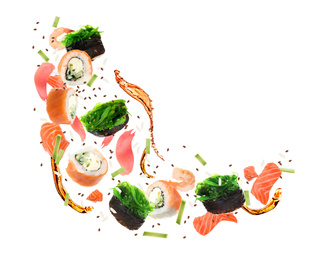 Different sushi rolls and ingredients on white background