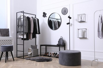 Dressing room with stylish clothes, shoes and accessories. Elegant interior design