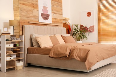 Comfortable bed with stylish linens. Interior design