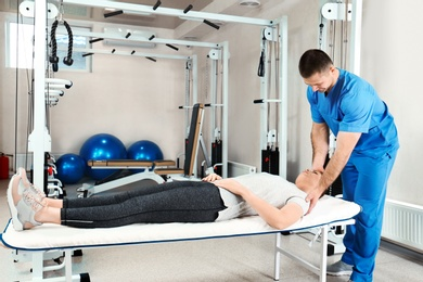 Physiotherapist working with patient in rehabilitation center
