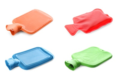 Set with different rubber hot water bottles on white background