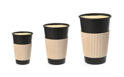 Set with different takeaway coffee cups on white background