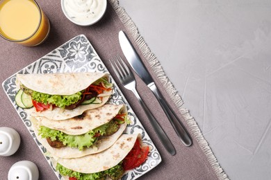 Delicious fresh vegan tacos served on light table, flat lay. Space for text