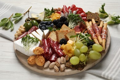 Different tasty appetizers on white wooden table