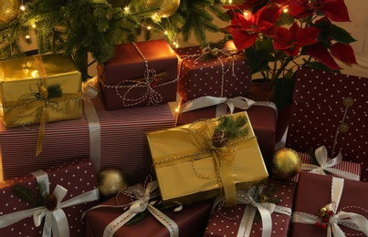 Many different beautiful gifts under Christmas tree