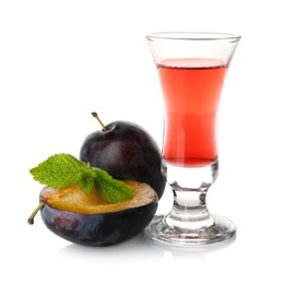 Delicious plum liquor, ripe fruits and mint on white background. Homemade strong alcoholic beverage