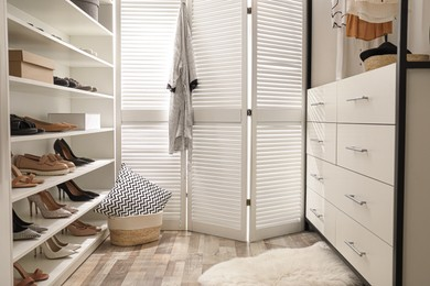 Dressing room interior with storage rack for shoes and accessories