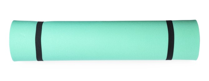 Turquoise rolled camping or exercise mat on white background, top view