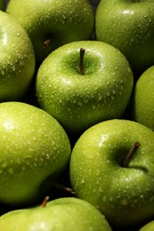 Ripe green apples with water drops as background, closeup