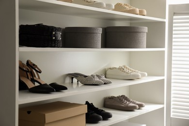 Storage rack with stylish women's shoes indoors