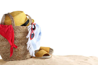 Composition with beach objects on sand against white background, space for text