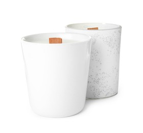 Beautiful candles with wooden wicks on white background