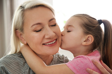 Mature woman with her little granddaughter at home