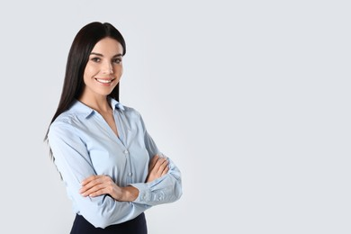 Portrait of young businesswoman on white background. Space for text