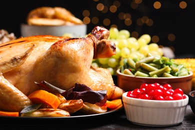 Traditional Thanksgiving day feast with delicious cooked turkey and other seasonal dishes served on table, closeup