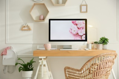 Stylish home office interior with comfortable workplace