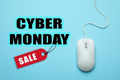 Text Cyber Monday Sale and wired computer mouse on light blue background, top view