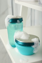 Hair care cosmetic products with foam on shelf indoors