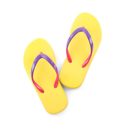 Pair of stylish yellow flip flops isolated on white, top view. Beach object