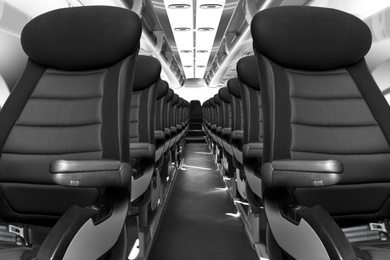 Modern airplane cabin with comfortable seats