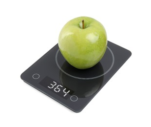 Ripe green apple and electronic scales on white background