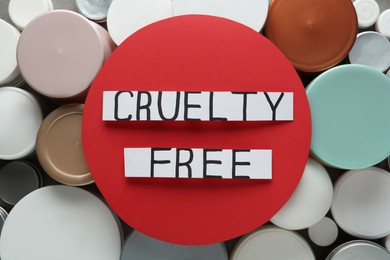 Cards with text Cruelty Free on personal care products, top view. Stop animal tests