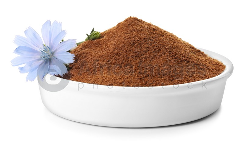 Plate of chicory powder and flower on white background