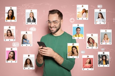 Handsome man visiting online dating site via smartphone on pink background