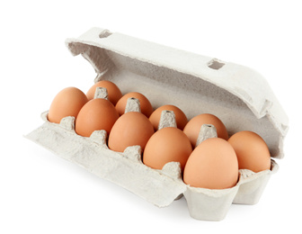 Raw chicken eggs in carton isolated on white