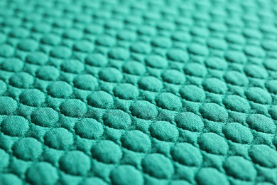 Textured turquoise fabric as background, closeup view