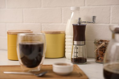 Manual coffee grinder on counter in kitchen