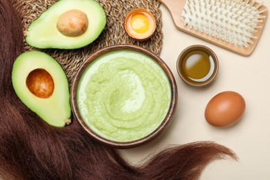 Flat lay composition with homemade hair mask and ingredients on beige background