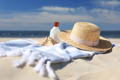 Stylish beach accessories for summer vacation on sand near sea