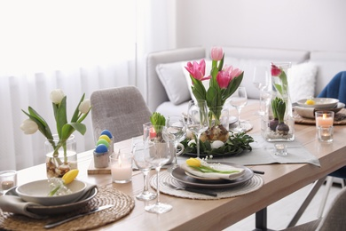 Beautiful Easter table setting with beautiful flowers in living room