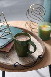 Stylish tray with different interior elements and coffee on wooden table indoors