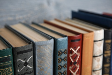 Stack of hardcover books on grey background, closeup