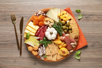 Different tasty appetizers on wooden table, flat lay