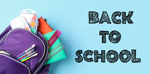 Text Back To School and backpack with different stationery on light blue background, top view. Banner design