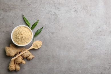 Dry ginger powder, fresh root and leaves on grey table, flat lay. Space for text