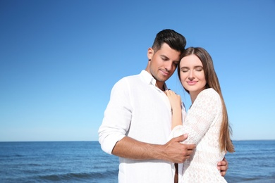 Lovely couple together on beach. Summer vacation