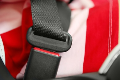 Driver with fastened safety belt in car, closeup
