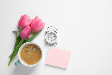 Composition with blank card and coffee on white background, top view. Good morning