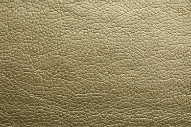 Texture of olive leather as background, closeup